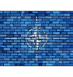 Flag of NATO on a brick wall vector image vector image