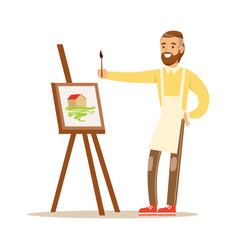 Man artist holding palette and brush standing near vector