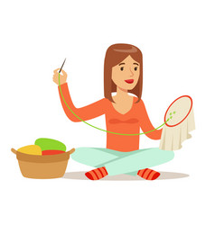 young woman sitting on the floor and embroidering vector image
