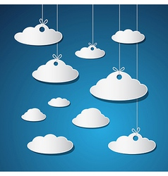 Paper clouds with strings on blue background vector