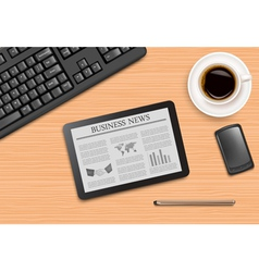 Tablet with news and office supplies laying on the vector image
