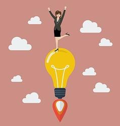 Business woman celebrating on a lightbulb idea vector