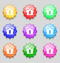Gift icon sign symbol on nine wavy colourful vector