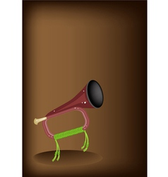 A musical bugle on dark brown background vector