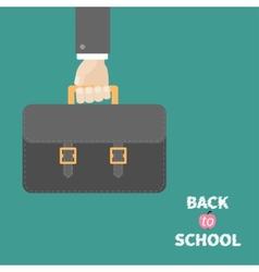 Hand holding black schoolbag briefcase Flat design vector image