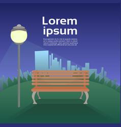 urban park in evening wooden bench under lantern vector image