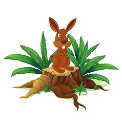 A rabbit on a stump with leaves vector
