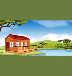Wooden cottage by the river vector