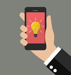 Hand holding smartphone with light bulb on display vector
