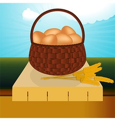 Wicker basket with eggs on the table vector image