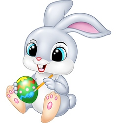 Cartoon funny Easter Bunny painting an egg vector image vector image