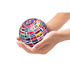 Flags of the world on a globe held in hands vector