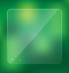 Glass frame with water drops on blurred green vector