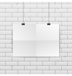 Sheet of folded paper hangs on the clamps vector
