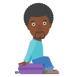 Man sitting on his suitcase vector