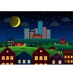 City and suburbs on hill at night vector