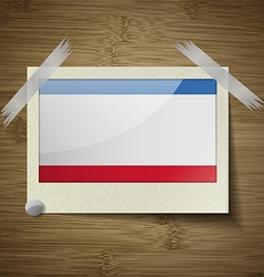 Flags crimea at frame on wooden texture vector
