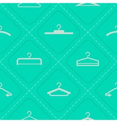 Seamless background with hangers vector