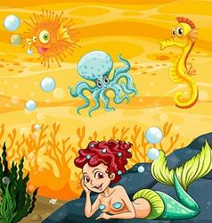 A mermaid under the sea vector
