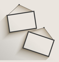 Blank photo frame hanging on wall vector