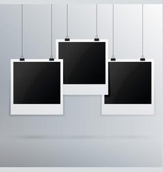 Hanging photo frame on gray background vector