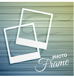 Two empty photo frames on wooden background vector