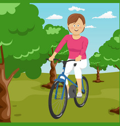 Young woman riding a bicycle in a park vector