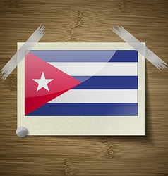 Flags cuba at frame on wooden texture vector