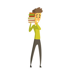 Young man standing and holding a stack of books vector