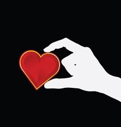 Heart lovely in hand on black vector