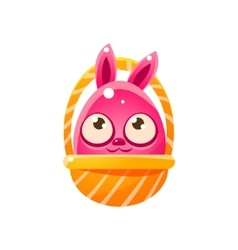 Pink egg shaped easter bunny in basket vector