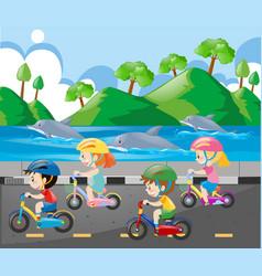 children riding bike along the ocean vector image