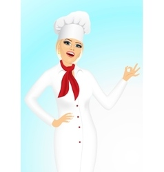 Smiling female chef cook or baker showing ok sign vector