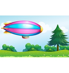A pink and blue colored aircraft above the hill vector image vector image