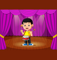 cute boy playing drum on stage vector image vector image
