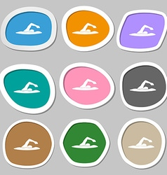 Swimmer symbols multicolored paper stickers vector