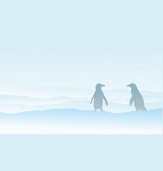 Silhouette penguin on snow landscape vector