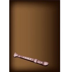 A musical recorder on dark brown background vector