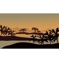 Silhouette of banana trees in riverbank vector