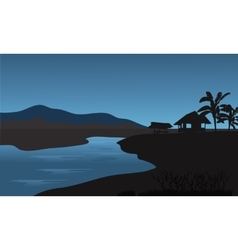 Silhouette of hut in riverbank vector