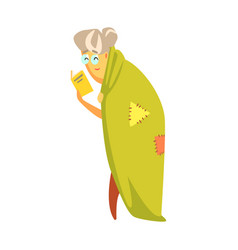 Senior woman standing covered with a green blanket vector