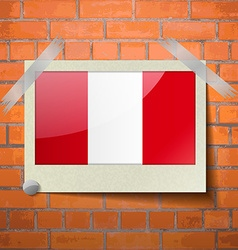 Flags peru scotch taped to a red brick wall vector