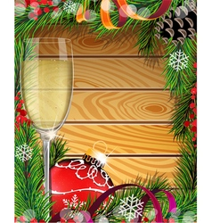 Glass of champagne and red christmas decoration vector