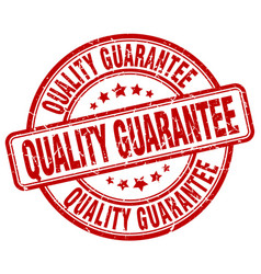Quality guarantee red grunge round vintage rubber vector