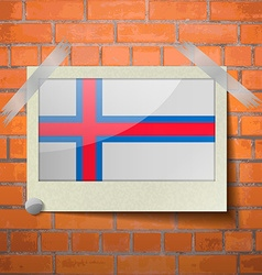 Flags Faroe Islands scotch taped to a red brick vector image