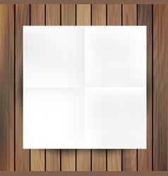White folded paper mockup card isolated on wood vector