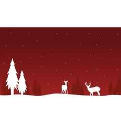 Silhouette of deer and spruce on red backgrounds vector