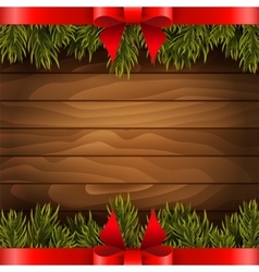 Christmas tree with red bow on the wood background vector image vector image