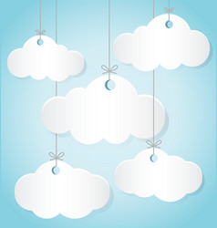 Paper clouds hanging the ropes on blue background vector