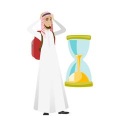 Worried muslim traveler man looking at hourglass vector